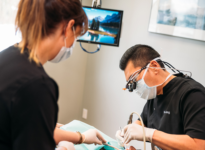 dentist and dental assistant working on patient using your dental benefits before year end