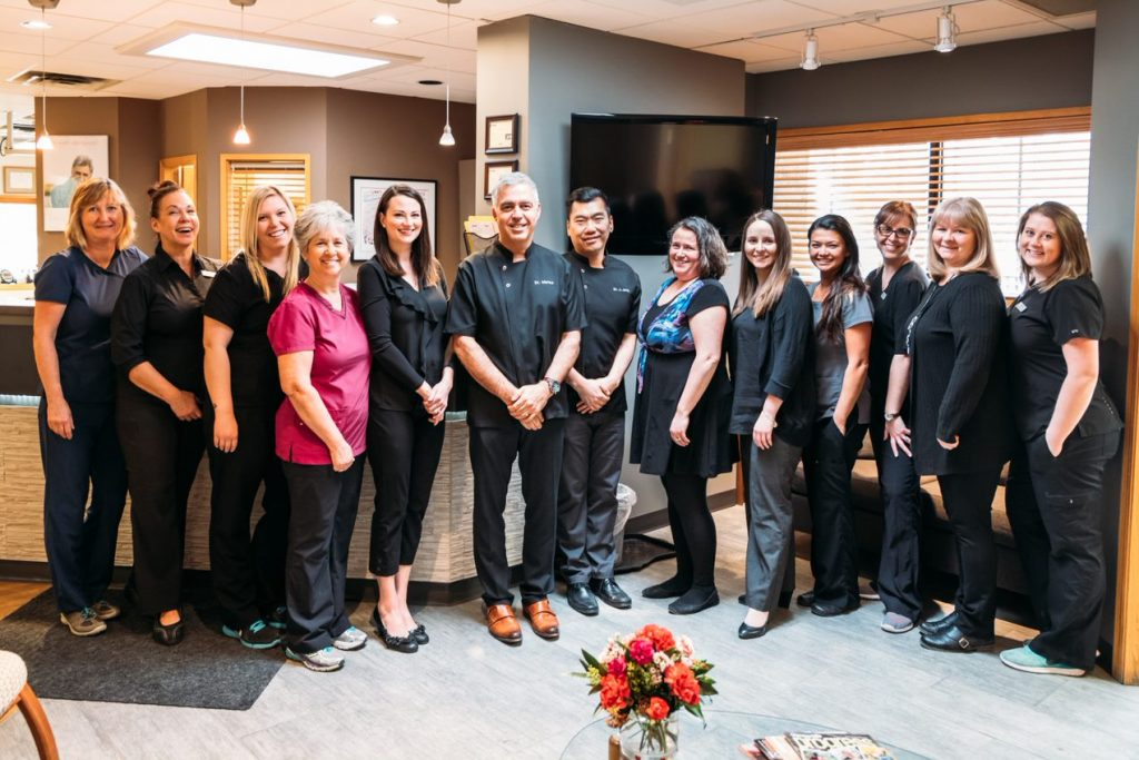 family-dental-centre-team-of-dental-staff-standing-together