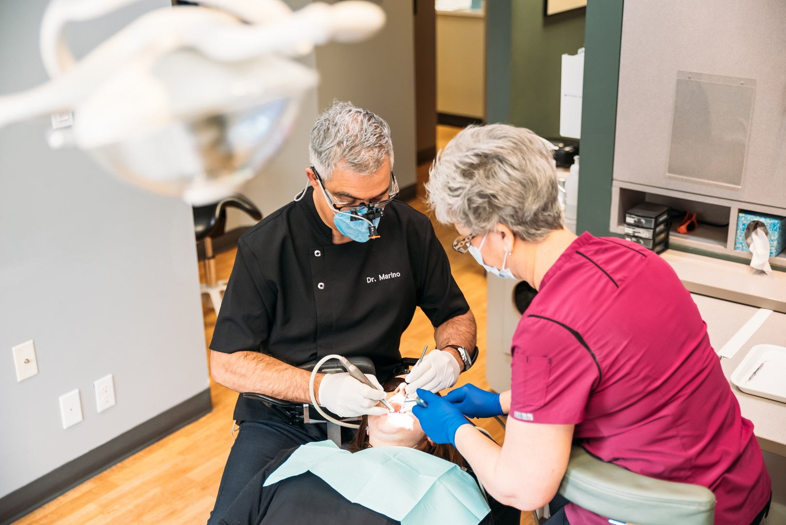 dentist and hygienist working on patient iv sedation dentistry