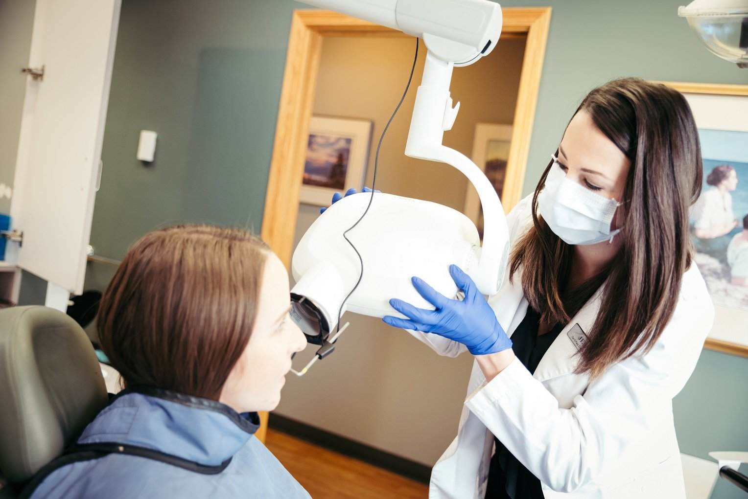 Photo 1 what is the process of getting veneers dental assistant taking x-rays