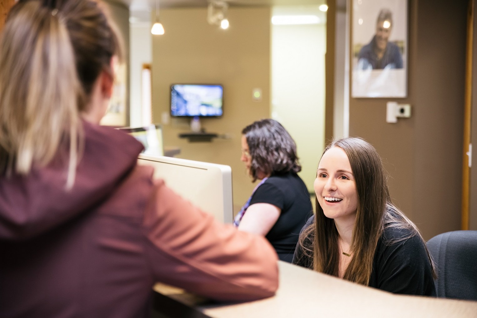 using your dental benefits by year end receptionist greeting patient