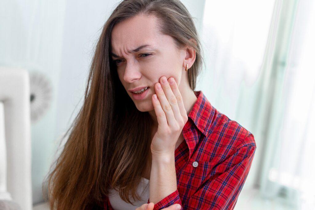 Young girl clenching teeth